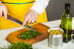 Woman finely shred dill Royalty Free Stock Photos