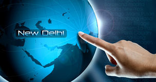 A woman finger and globe, New Delhi Stock Images
