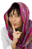 Woman with finger on her lips Stock Images