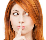 Woman with finger on her lips Stock Photo