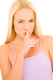 Woman with finger on her mouth Stock Image