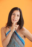 Woman With Finger On Lips Stock Photo