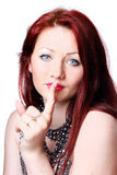 Woman with finger on lips Royalty Free Stock Image
