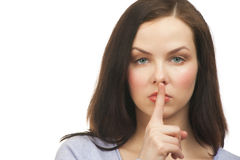 Woman with finger on lips Stock Images