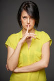 Woman with finger on lips Stock Photos