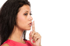 Woman with finger on lips showing silence gesture. Stock Images