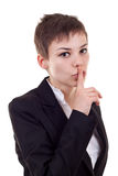 Woman with the finger near her lips Royalty Free Stock Photography