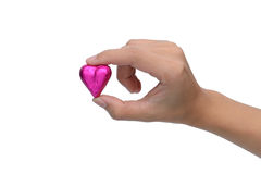 Woman finger pick heart chocolate Royalty Free Stock Images