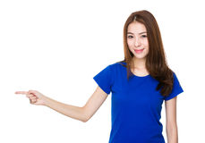 Woman with finger point aisde Stock Photo
