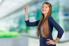 Woman with finger point aside Royalty Free Stock Photography