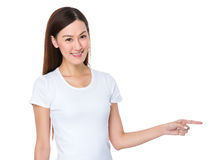 Woman with finger point aside Royalty Free Stock Photos