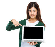 Woman finger point down to the blank screen of computer Royalty Free Stock Images