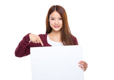Woman finger point down to placard Stock Photos