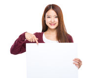 Woman finger point down to white board Royalty Free Stock Photo