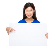 Woman finger point to the blank placard Royalty Free Stock Photos