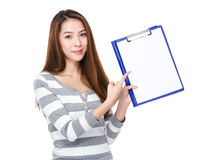 Woman finger point to clipboard Stock Images