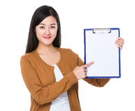 Woman finger point to the clipboard royalty free stock photos