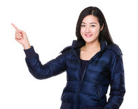 Woman with finger point up Stock Image