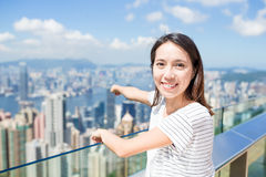 Woman finger pointing down to the city of Hong Kong Stock Photos