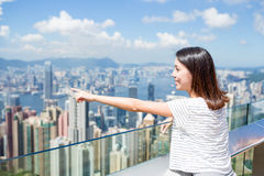 Woman finger pointing out the location in Hong Kong Stock Photo