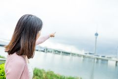 Woman finger pointing to the landmark in Macao Stock Photo