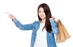 Woman finger pointing up with shopping bag Stock Image