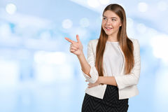 Woman with finger points aside Stock Photography