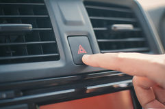 Woman finger pressing emergency button. Royalty Free Stock Images