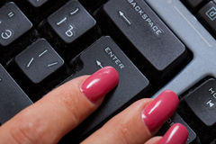 Woman finger push enter button Royalty Free Stock Images