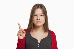 Woman with finger raised Royalty Free Stock Photo