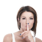 Woman with finger to lips Royalty Free Stock Photos