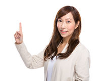 Woman with finger up Stock Images