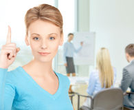 Woman with finger up at office Royalty Free Stock Photo