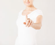 Woman with finger up Stock Photography