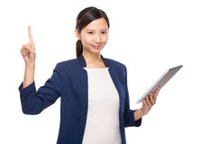 Woman finger up with tablet Royalty Free Stock Photography
