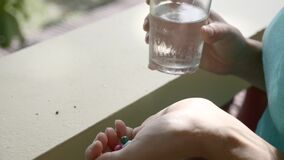 Pills in the Hand. Woman fingering pills in her hand. Young girl taking medicaments stock video footage