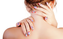 Woman with fingernails. The young woman from a back, embraces itself a neck two hands with beautiful nails royalty free stock image