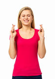 Woman With Fingers Crossed On White Background Royalty Free Stock Image
