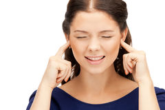Woman with fingers in ears Royalty Free Stock Photo