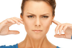 Woman with fingers in ears Stock Photo