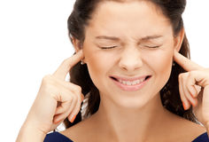 Woman with fingers in ears. Picture of woman with fingers in ears Royalty Free Stock Photos