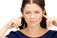 Woman with fingers in ears Stock Photography