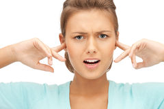 Woman with fingers in ears Royalty Free Stock Images