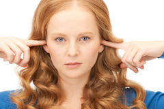 Woman with fingers in ears Royalty Free Stock Image