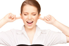 Woman with fingers in ears. Picture of woman with fingers in ears Royalty Free Stock Photography