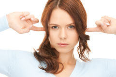Woman with fingers in ears Stock Images