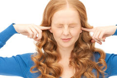 Woman with fingers in ears Royalty Free Stock Photos