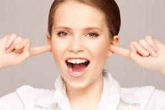 Woman with fingers in ears. Picture of woman with fingers in ears Royalty Free Stock Photo