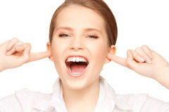 Woman with fingers in ears. Picture of woman with fingers in ears Royalty Free Stock Image