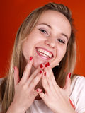 Woman with fingers over her face Stock Photos